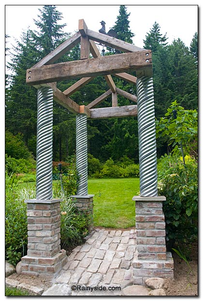 Arbor made from brick, steel and wood